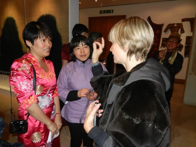 Anna Valentine discussing the techniques with the Chinese weaver herself and an interpreter