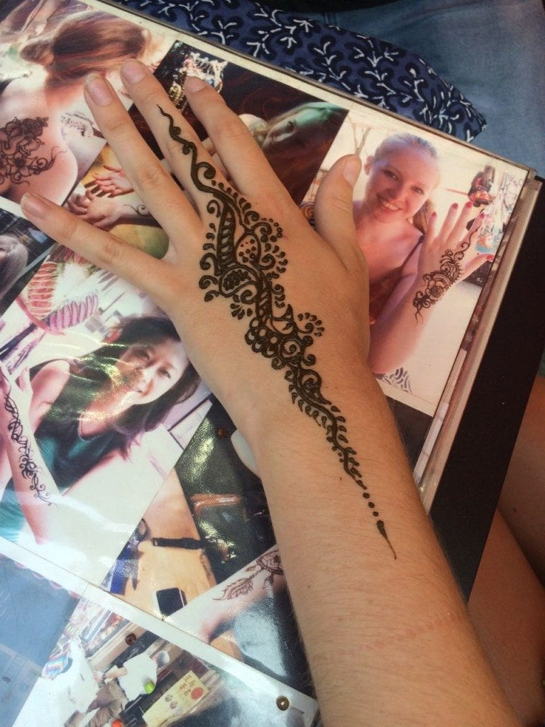Having our henna tattoos in Chinatown