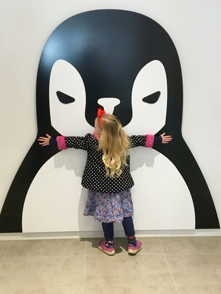 Hugging the penguin