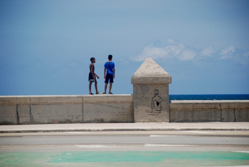 Cuba, boys on sea wall