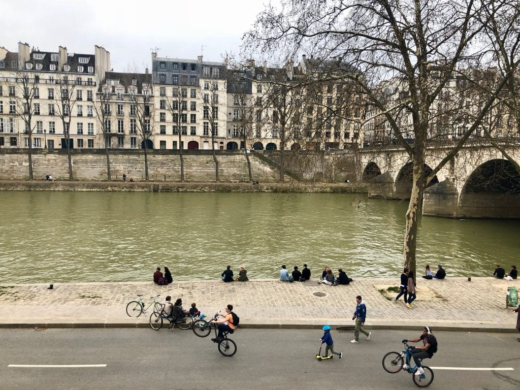 Cyclists by the Seine